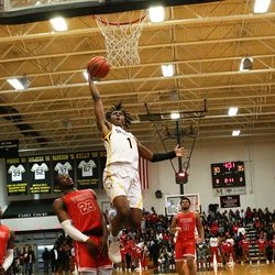 Marian Catholic's Ahron Ulis (1) drives to the basket for a layup against Homewood-Flossmoor.