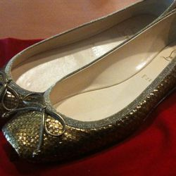 New to this sale! Python ballet flats. $325.