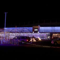 """Vehicles wind through """"Light the RioT,"""" a drive-thru light show, outside Rio Tinto Stadium in Sandy on Monday, May 4, 2020."""