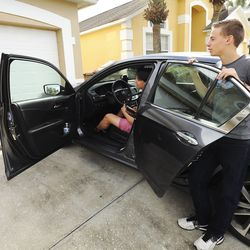 Kelsie, Taylor and Adam Wakefield prepare to drive at their home in Kissimmee, Fla., on Monday Dec 21, 2020.