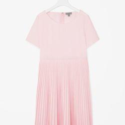 "Pleated poplin dress in powder pink, <a href=""http://www.cosstores.com/us/women/dresses/pleated_poplin_dress/46881-16057076.1#c-15133319"">$80</a>"