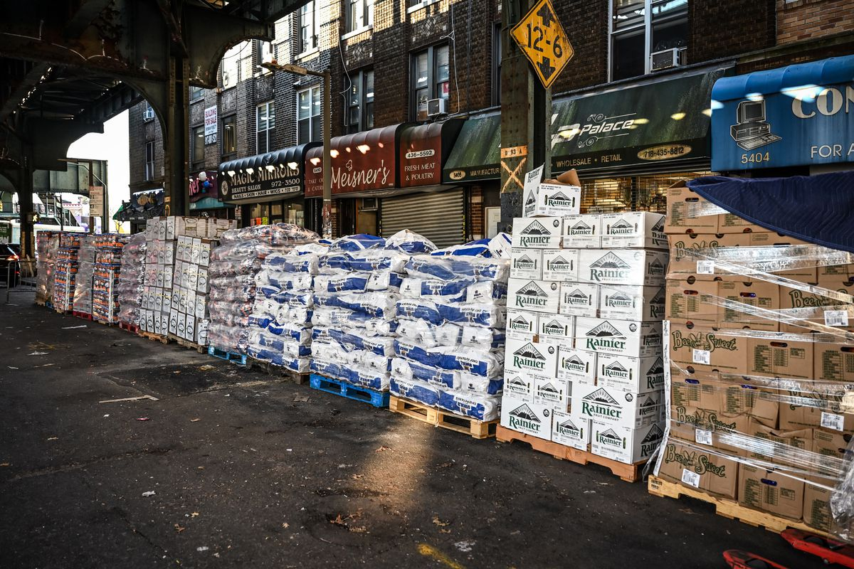 Masbia food pantry workers stacked recently-delivered food along New Utrecht Avenue in Borough Park.