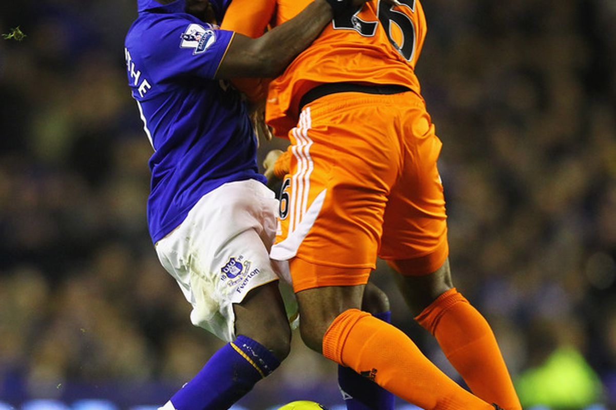 Royston Drenthe tangles with Kemy Agustien of Swansea during the Barclays Premier League match between Everton and Swansea City at Goodison Park on December 21, 2011.  (Photo by Matthew Lewis/Getty Images)