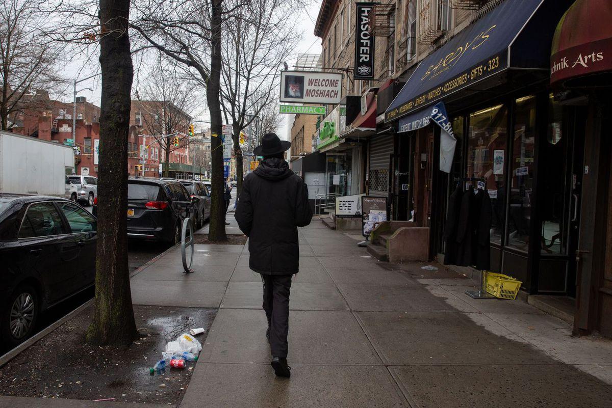 A man walks along Kingston Avenue in Crown Heights.