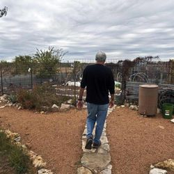 In this Tuesday, November 8, 2011, photo, Dr. Dewayne Nash walks out to his garden at his home in Bertram, Texas. Dr. Nash, a former family doctor practicing medicine in Bertram, is diagnosed with AlzheimerÍs disease.
