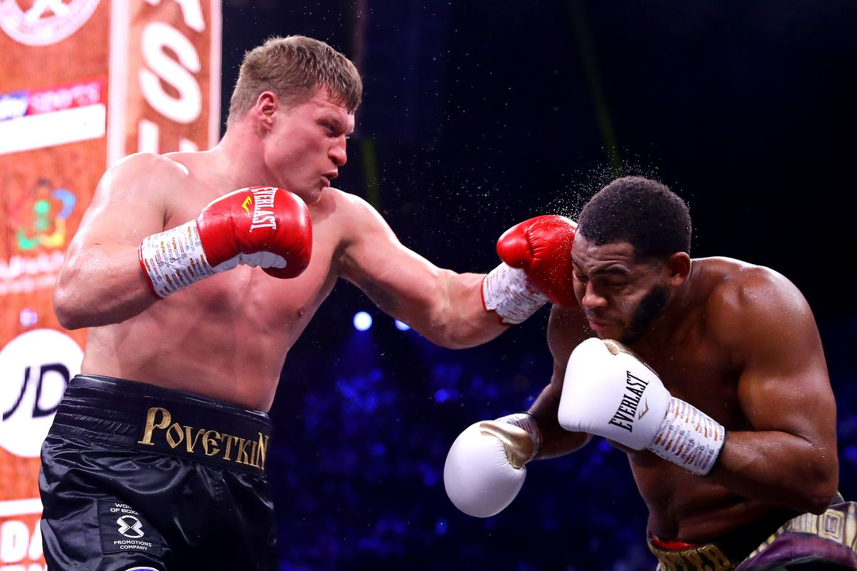 Alexander Povetkin punches Michael Hunter during the of the WBC World Heavyweight Eliminator fight between Alexander Povetkin and Michael Hunter during the Matchroom Boxing 'Clash on the Dunes' show at the Diriyah Season on December 07, 2019 in Diriyah, Saudi Arabia