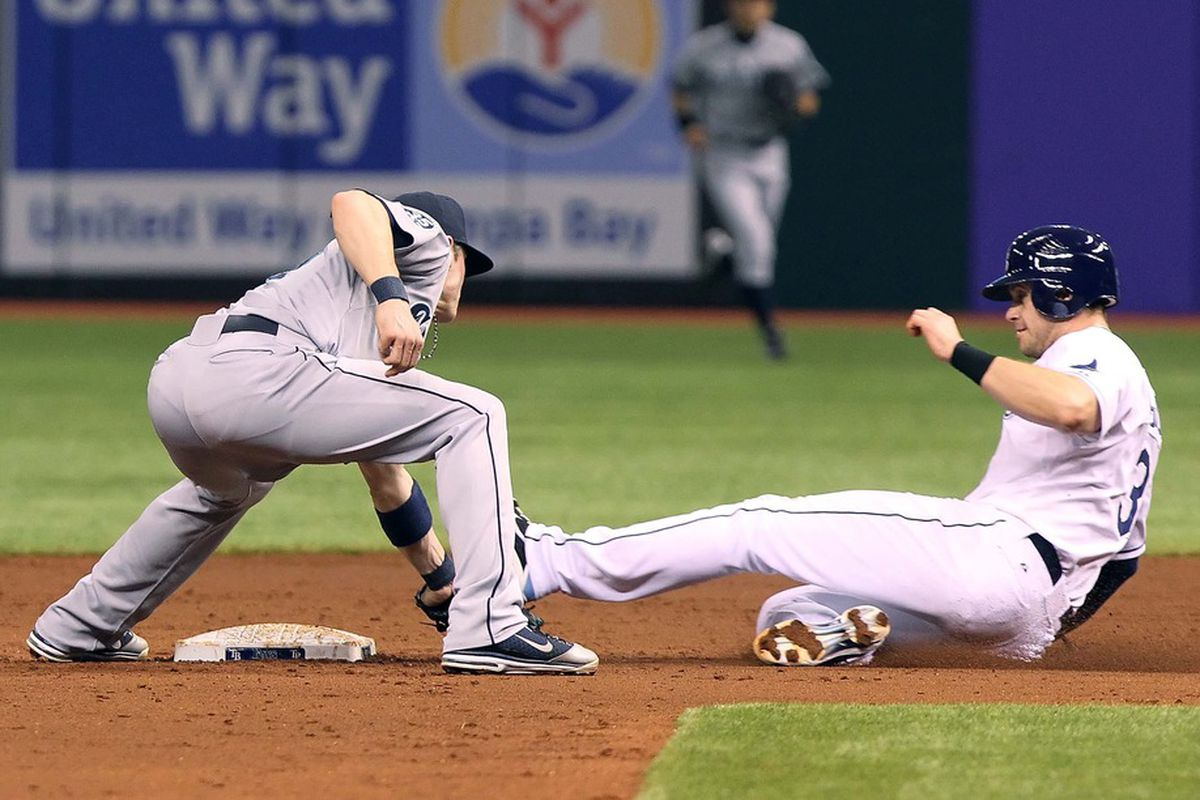 Seattle Mariners shortstop Brendan Ryan tags out Tampa Bay Rays third baseman Evan Longoria. Mandatory Credit: Kim Klement-US PRESSWIRE
