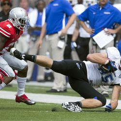 Buffalo Bulls tight end Mason Schreck (85) makes a diving catch under coverage from Ohio State Buckeyes safety Christian Bryant (2) at Ohio Stadium.