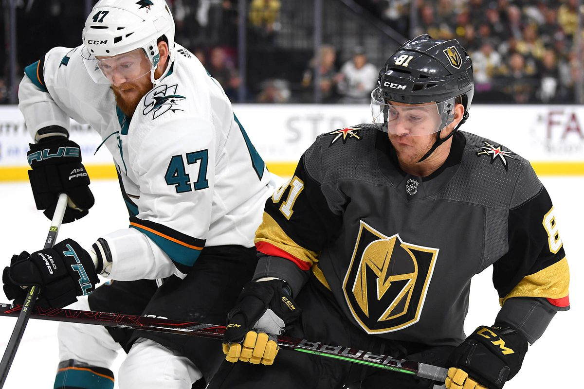 San Jose Sharks defenseman Joakim Ryan (47) and Vegas Golden Knights center Jonathan Marchessault (81) skate for the puck during the second period in game four of the first round of the 2019 Stanley Cup Playoffs at T-Mobile Arena.
