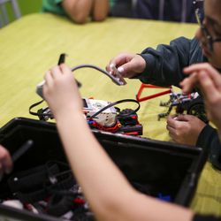 Students build robots out of Lego blocks during a Lego Camp at Zaniac Learning in Salt Lake City on Monday, Feb. 20, 2017.