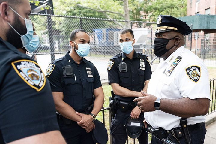 NYPD Chief of Community Affairs Jeffrey Maddrey speaks with officers.