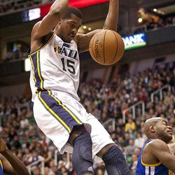 Jazz forward Derrick Favors (15) slam dunks the ball during the first half of the NBA basketball game between the Utah Jazz and the Golden State Warriors at Energy Solutions Arena, Wednesday, Dec. 26, 2012.