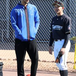 Yu Darvish talks with former teammate Kenshi Sugiya during a visit with his former team, the Hokkaido Nippon-Ham Fighters, who spend part of their Spring Training at Salt River Fields, in scottsdale, AZ.   John Antonoff/For the Sun-Times