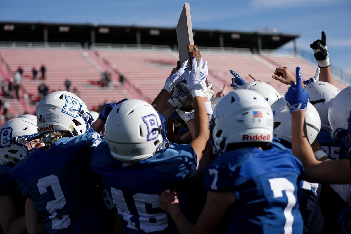 Beaver players celebrate their win over Duchesne in the 2A football championship game at Dixie State University in St. George on Saturday, Nov. 14, 2020.