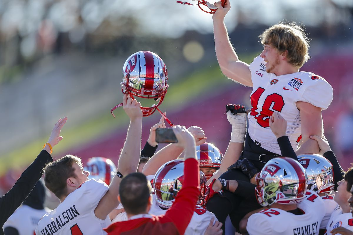 Western Kentucky Hilltoppers place kicker Cory Munson (46) is carried off the field after kicking a field goal to win the game between the Western Kentucky Hilltoppers and the Western Michigan Broncos on December 30, 2019 at Gerald Ford Stadium in Dallas, Texas.