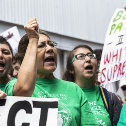 Maria Partida, of Centro de Trabajadores Unidos, joins dozens of other immigrant rights activists to protest outside the Marriott Marquis Chicago on Tuesday while U.S. Customs and Border Protection hosts the 2019 Trade Symposium.