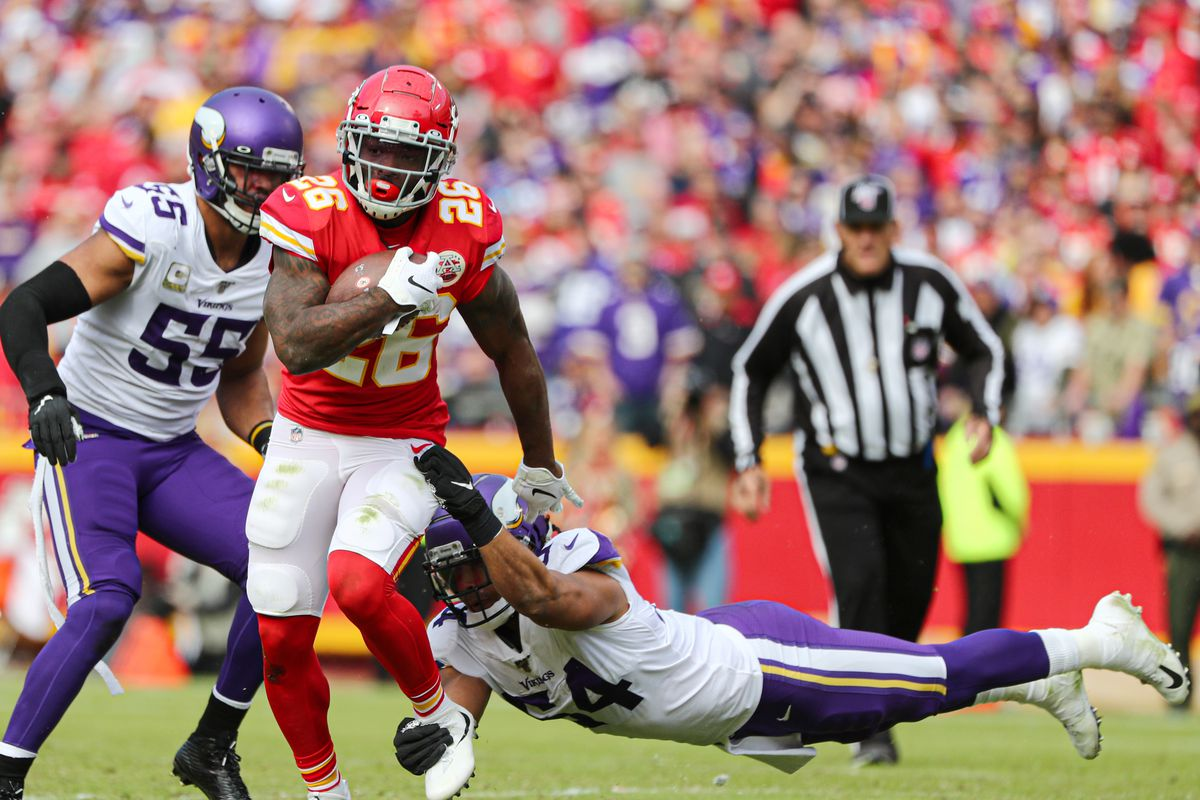 Kansas City Chiefs running back Damien Williams (26) is tackled by Minnesota Vikings middle linebacker Eric Kendricks (54) during the first half at Arrowhead Stadium.