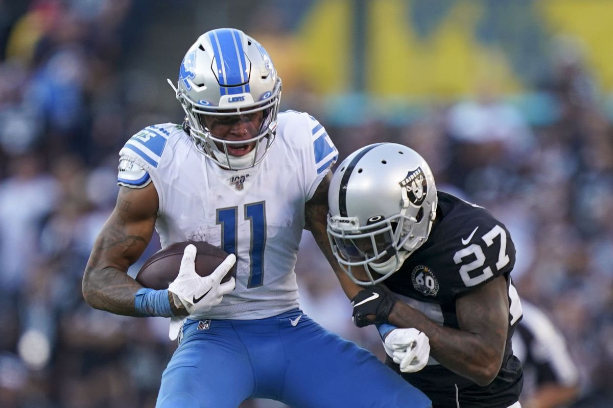 Detroit Lions wide receiver Marvin Jones Jr. is tackled by Oakland Raiders cornerback Trayvon Mullen during the fourth quarter at Oakland Coliseum.