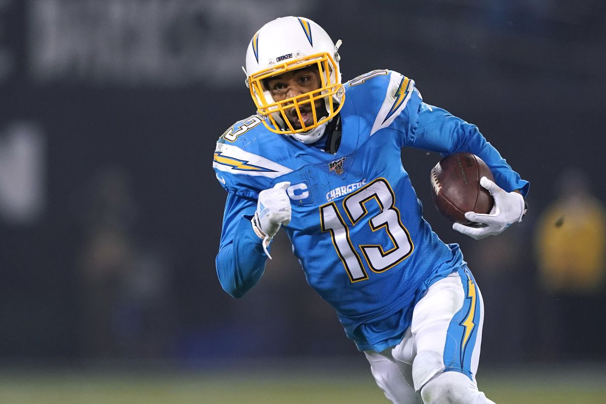 Los Angeles Chargers wide receiver Keenan Allen carries the ball after a catch during the fourth quarter against the Oakland Raiders at Oakland Coliseum.