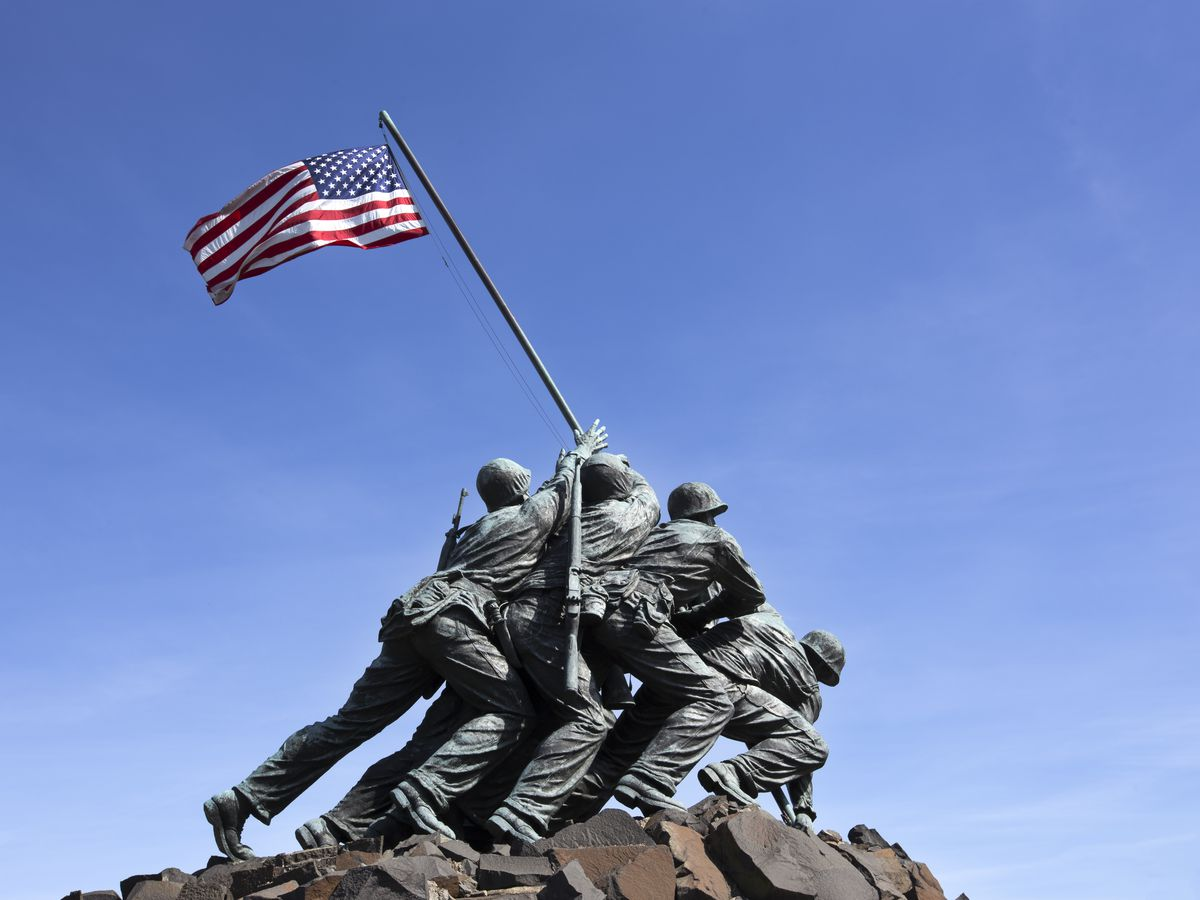 A statue of several soldiers holding up an American flag. The statue depicts the famous Iwo Jima landing during World War II.