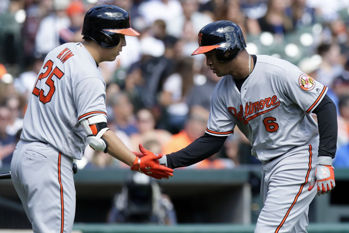Jonathan Schoop is congratulated by Hyun Soo Kim after homering against the Tigers.