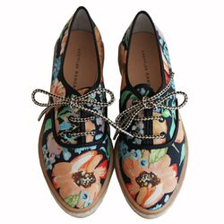"""Loeffler Randall <a href=""""http://shop.tenover6.com/collections/women-shoes/products/odile-tennis-shoe"""">Odile tennis shoe</a>: """"Yes, it's another pair of floral kicks. Can you blame me? I'd sleep with these at night if I could!"""""""