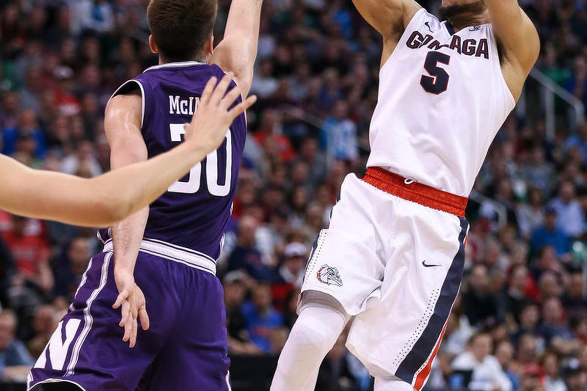 Gonzaga Bulldogs guard Nigel Williams-Goss (5) shoots over Northwestern Wildcats guard Bryant McIntosh (30) during the game at Vivint Smart Home Arena in Salt Lake City on Saturday, March 18, 2017.