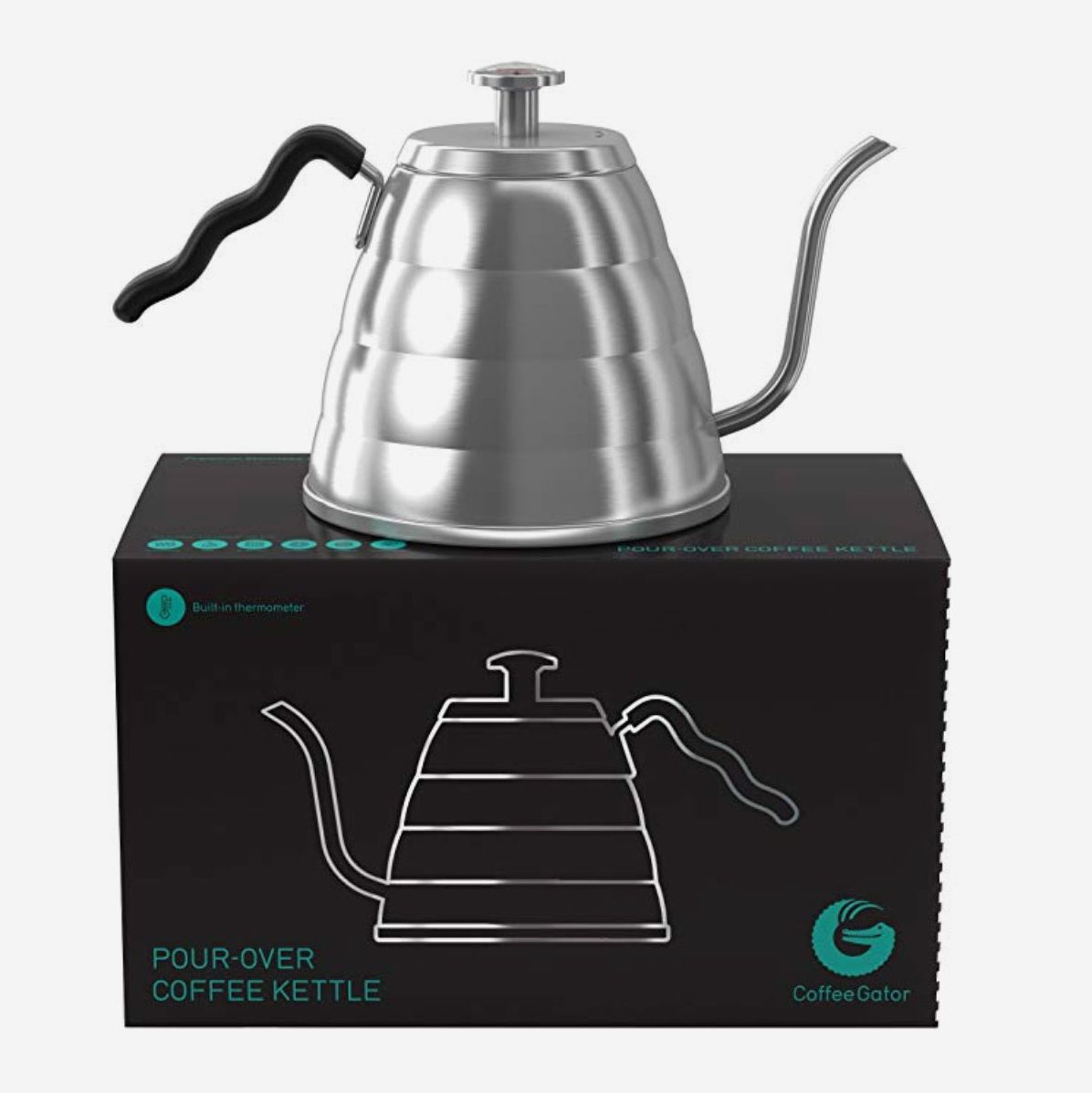 A stainless steel pour over kettle on the box it comes in
