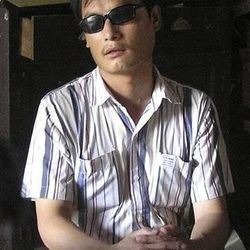 In this undated photo provided by supporters of Chen Guangcheng, blind activist Chen Guangcheng sits in a village in China. Guangcheng escaped house arrest earlier this week and is in the presumed custody of U.S. diplomats.