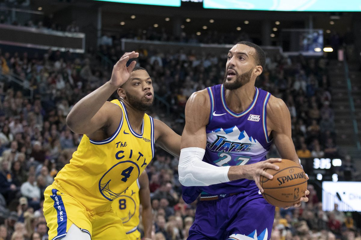 Utah Jazz center Rudy Gobert drives to the basket while defended by Golden State Warriors forward Omari Spellman during the second half at Vivint Smart Home Arena.