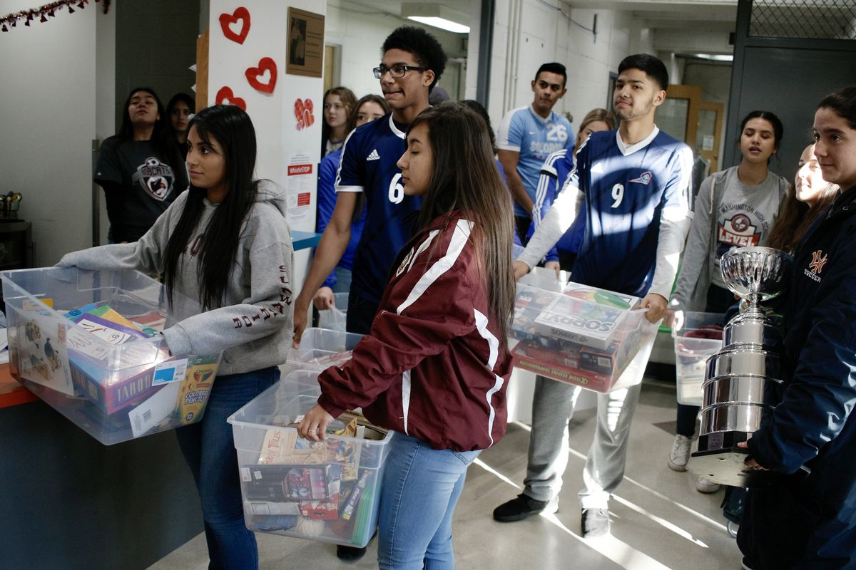 The athletes deliver a load of donations at the Hyde Park Community Center; they also brought the PepsiCo Showdown Cup.   Bobby Johandes/Buddy's Helpers