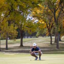 Corner Canyon's Alex Edwards checks his line during the 6A boys state tournament at Davis Park Golf Course in Kaysville on Tuesday, Oct. 5, 2021.
