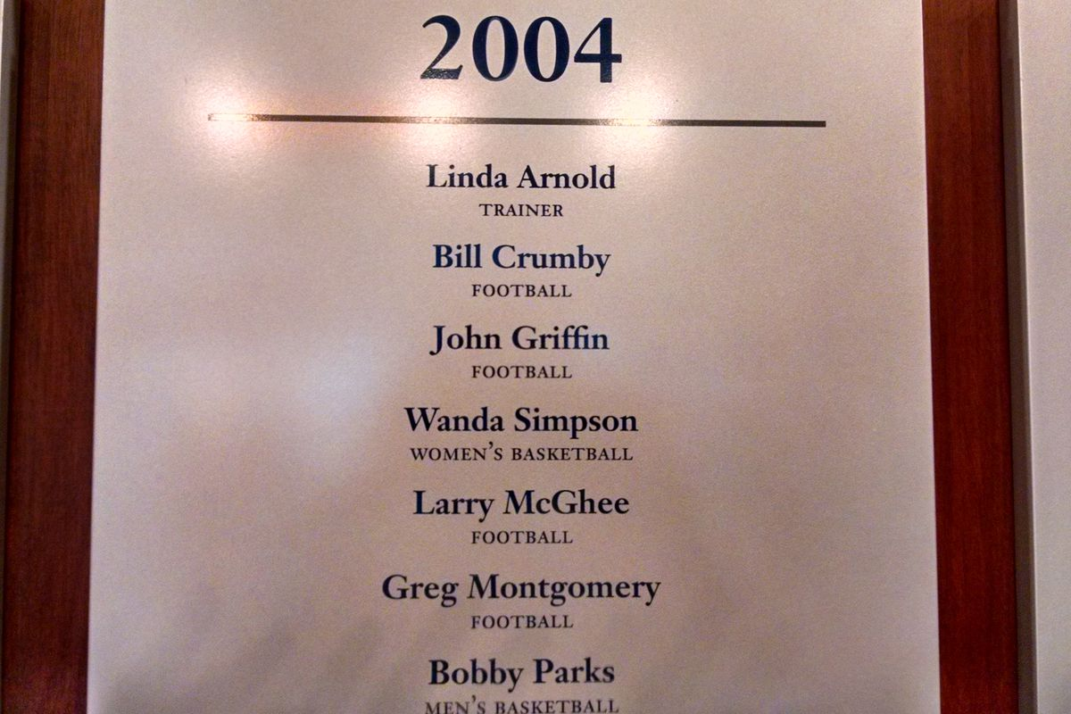A plaque in the Memphis Athletics Hall of Fame lists the 2004 M Club inductees. Bill Crumby's name is second from the top.
