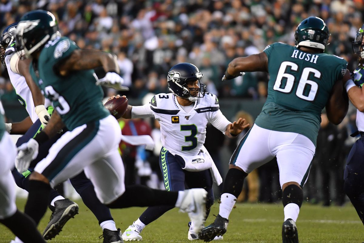Seattle Seahawks quarterback Russell Wilson looks to pass in the first quarter against the Philadelphia Eagles in a NFC Wild Card playoff football game at Lincoln Financial Field.