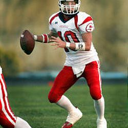 The passing of Springville's Scott Pickering complements Red Devil RB Trevyn Smith.