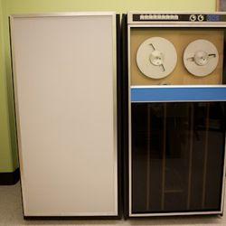 A fake hard drive next to a fake Sigma 7