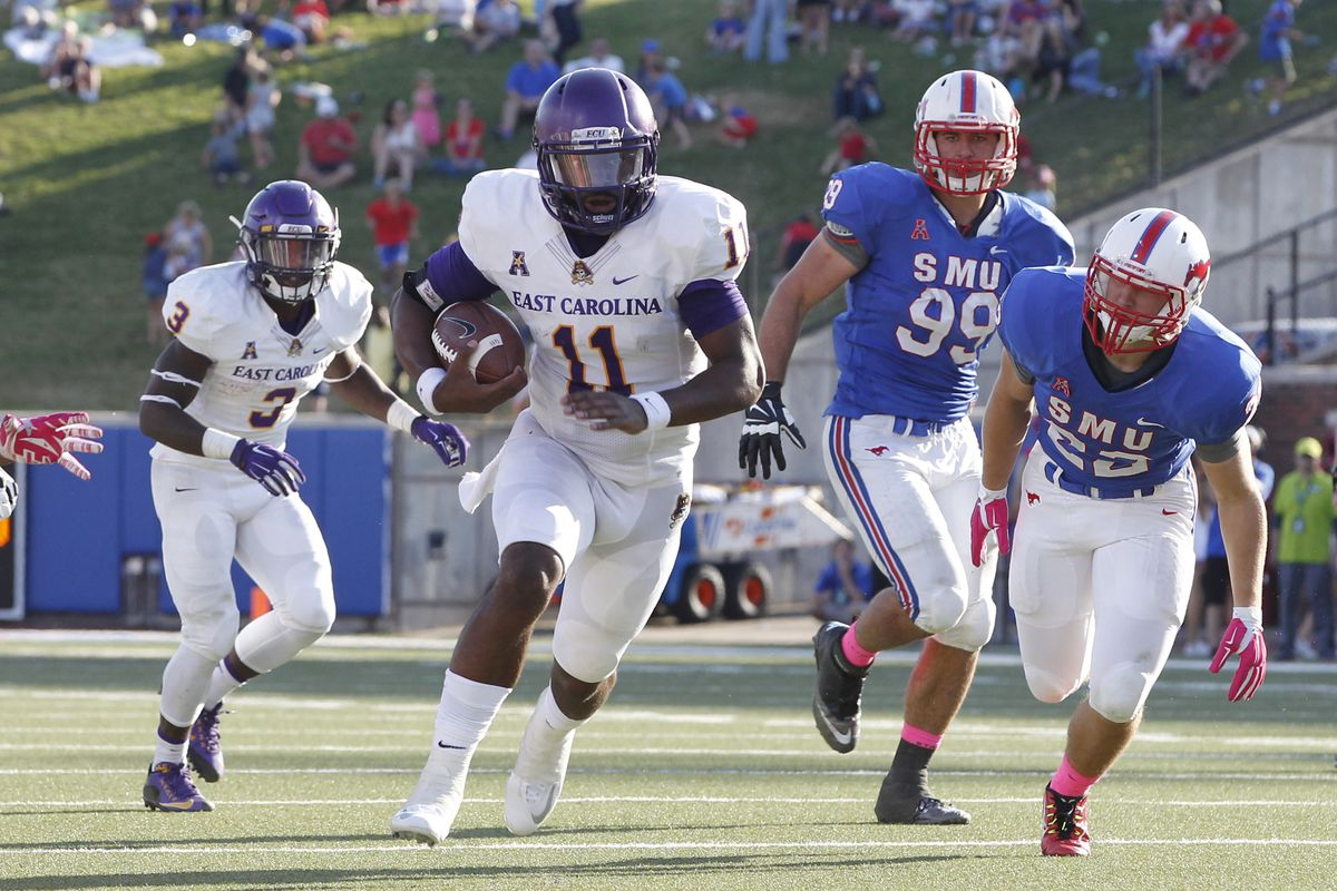 James Summers rushes for the Pirates against the Mustangs