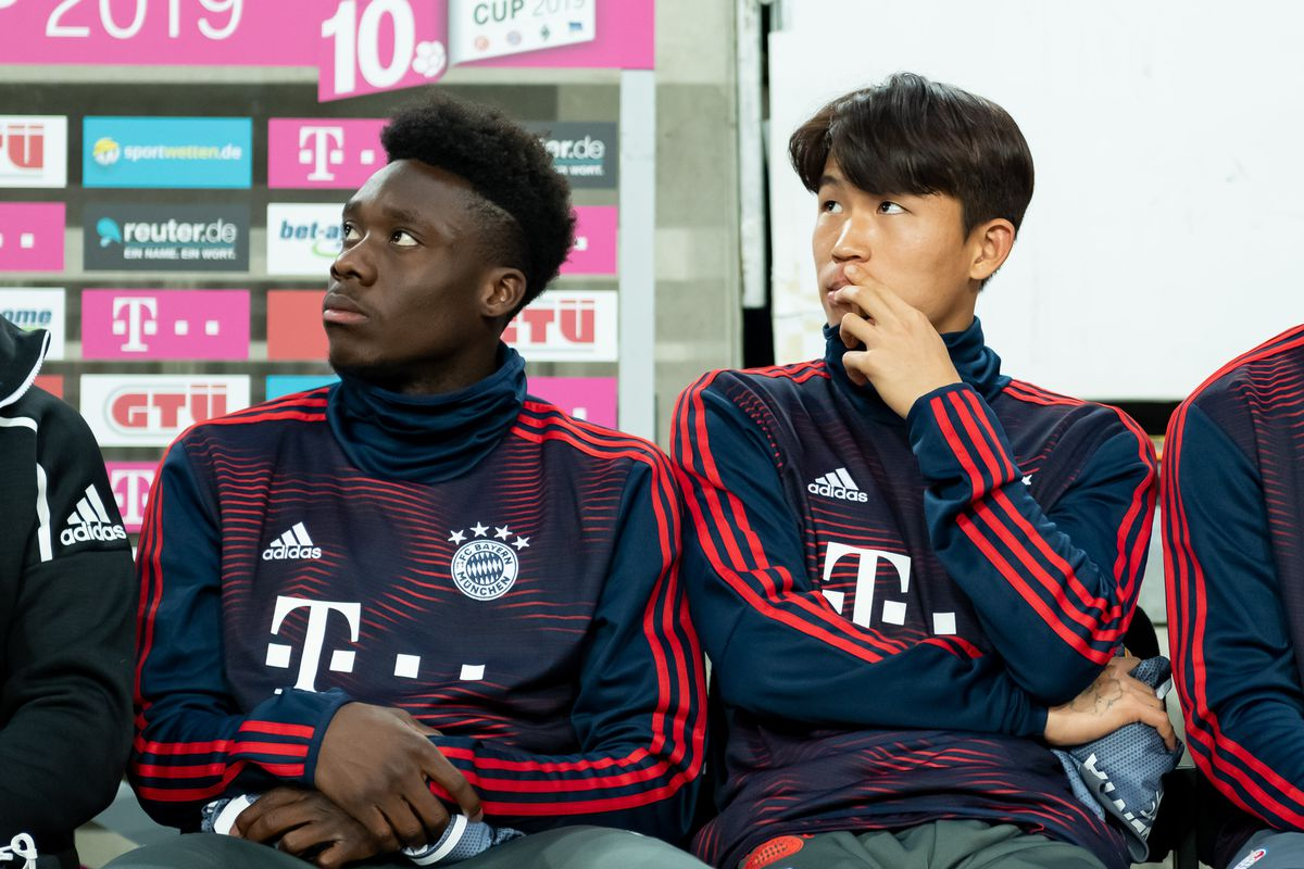 DUESSELDORF, GERMANY - JANUARY 13: Alphonso Davies of Bayern Muenchen and Wooyeong Jeong of Bayern Muenchen on the bench during the Telekom Cup Semifinal match between Fortuna Duesseldorf and Bayern Muenchen at Merkur Spiel-Arena on January 13, 2019 in Duesseldorf, Germany.