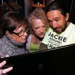 Jackie Biskupski looks at election results with staff members Maryann Martindale, left, and Matthew Rojas at her election night party in Sugar House on Tuesday, Nov. 3, 2015.