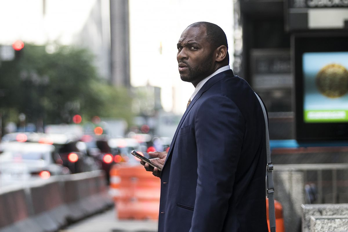 Former NFL linebacker Adalius Thomas, who played for the Ravens and the Patriots, leaves court after testifying Wednesday afternoon against tax lawyer Gary Stern who scammed him and other NFL players. | Ashlee Rezin/Sun-Times