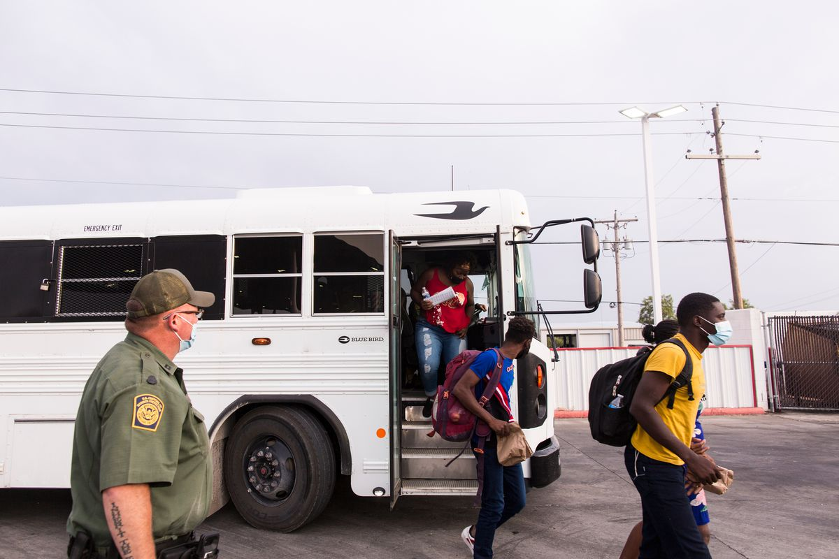 U.S. Customs and Border Protection drops off asylum seekers at a Del Rio, Texas gas station after their asylum application was initiated, Sept. 25, 2021.