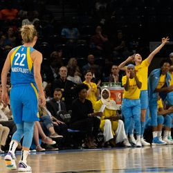 Courtney Vandersloot knocks down a three and the Sky bench erupts.