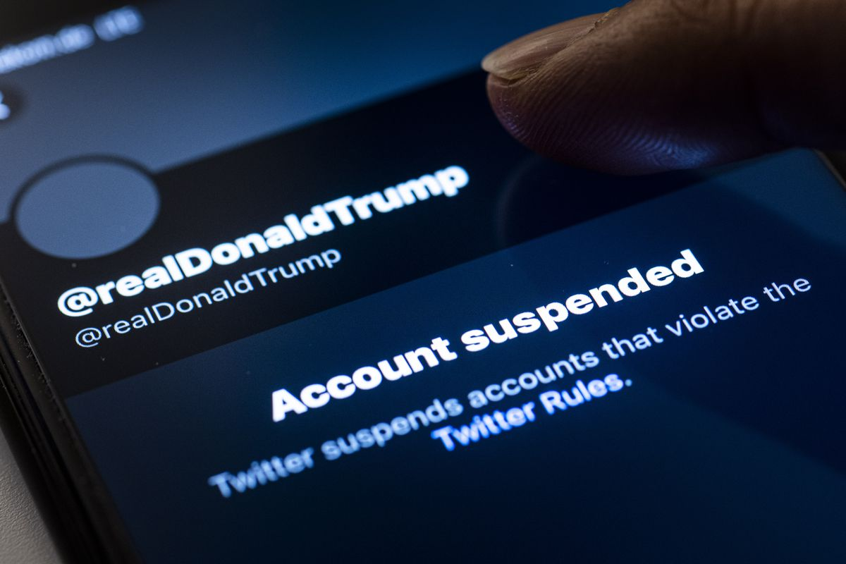 """Image of a screen showing Trump's Twitter account and an """"account suspended"""" notification."""