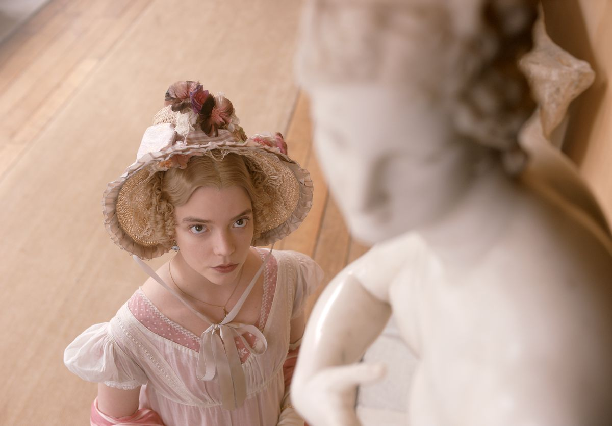 anya taylor-joy as emma, looking up at a statue