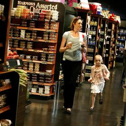 Ada Bowler and her daughter, Annie, 5, shop at Harmons in Salt Lake City on Wednesday, Aug. 15, 2012. Local business and civic leaders unveiled a new economic study that shows spending money at local businesses can have a bigger impact on the local economy than spending at national chains.