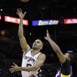 San Antonio Spurs' Tony Parker, of France, shoots as Los Angeles Lakers' Ramon Sessions defends during the first quarter of an NBA basketball game, Wednesday, April 11, 2012, in San Antonio.