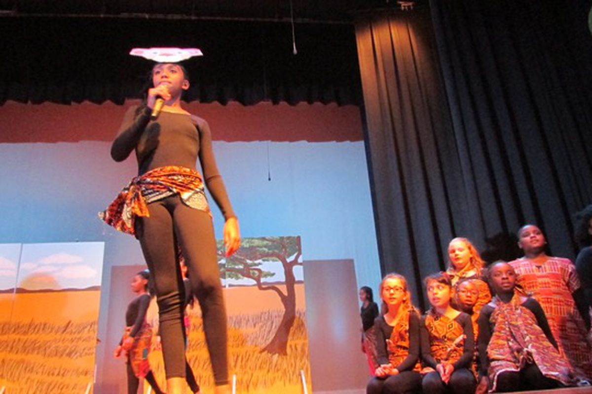 Destiney Rivers sings in a performance of songs from the musical The Lion King at the new Edison School for the Arts.