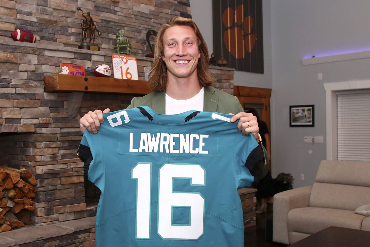 In this handout photo provided by the National Football League, quarterback Trevor Lawrence poses after being selected with the first overall pick by the Jacksonville Jaguars in the 2021 NFL Draft on April 29, 2021 in Seneca, South Carolina.