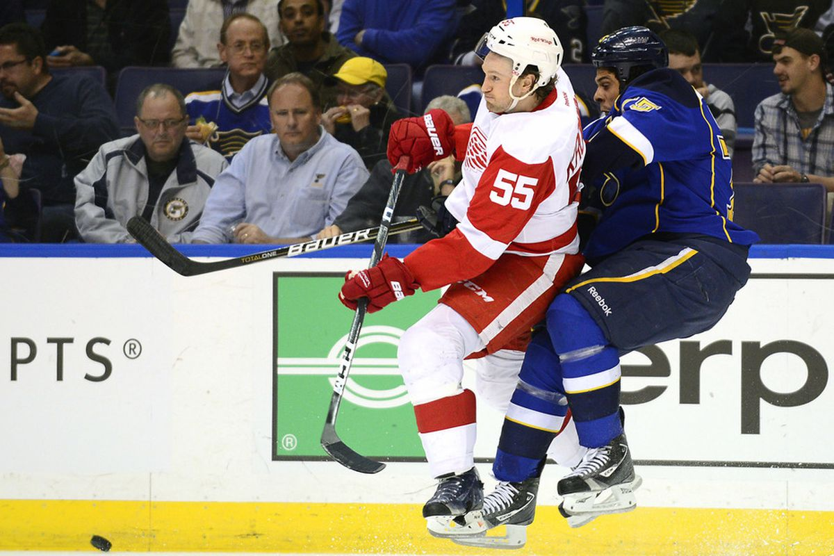 Mar 4, 2012; St. Louis, MO, USA; Detroit Red Wings defenseman Niklas Kronwall (55) checks St. Louis Blues right wing Ryan Reaves (75) during the first period at the Scottrade Center. Mandatory Credit: Scott Rovak-US PRESSWIRE