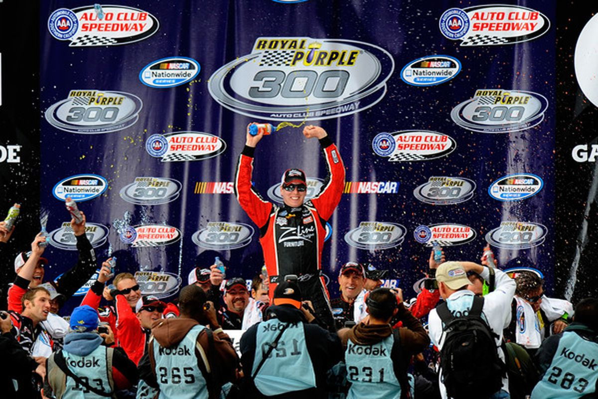 Sprint Cup Series driver Kyle Busch celebrates in victory lane after winning the NASCAR Nationwide Series Royal Purple 300 at Auto Club Speedway.